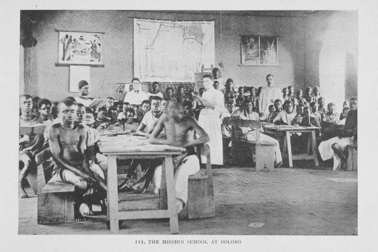Photograph of students in classroom with teachers