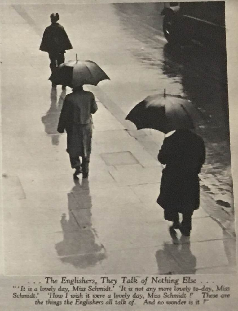 People walking on sidewalk in the rain, two with umbrellas and one with a cloak